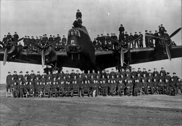 75(NZ) Squadron RAF . Aircrew pose on and around a Stirling Bomber
