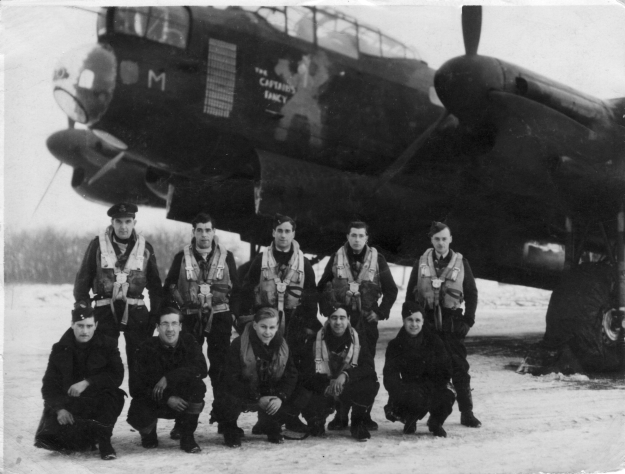 The Bailey crew in front of NE181 JN-Mike 'The Captains Fancy', just after 'bombing up' 29th January 1945. L to R (back row), Jack Brewster (Nav), Norman Bartlett (F/E), Jack Bailey (Pilot), Jack Wall (A/B), Dick Pickup (W/Op). (front row) Sgt. Phillips, unknown ground crew member, Roy Corfield (R/Gnr), Tony Gregory (MUG), unknown ground crew member. picture supplied by Tony Pickup ©