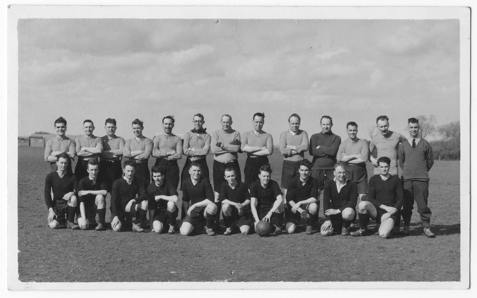 Groundcrew (back row) versus aircrew (front row) football match. Jimmy is 4th from right, front row.© Jimmy Wood collection.