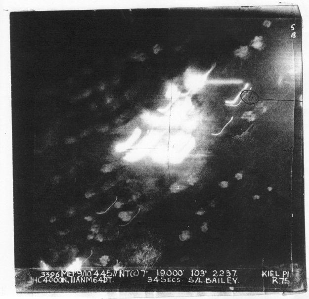 "KIEL NIght 9/10.4.45. 19,000' Aircraft ""K"" Our last Operation. Bombed on Markers Note 2 other aircraft below us shown on photo."