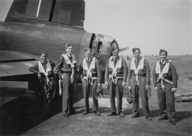 Stood in front of the tail of a Stirling, one assumes therefore at 1958 C.U. at Chedburgh. Reg is stood second from the left. Scott Weeden
